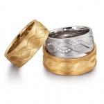 Bijzondere trouwringen 7,8 mm breed 50 diamanten 0.25 ct