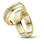 Prachtige trouwringen- twee geelgouden en één witgouden baan