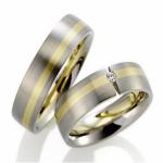 Trouwringen-geelgouden band, diamant in spanzetting