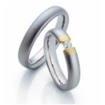 Platina trouw ringen met geelgouden zetting diamant briljant