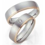 Trouwringen wit-geelgoud gematteerd met diamantje in damesring