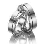 Trouwringen met in trouwring van dame een diamant van 0.12ct