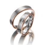 Trouwringen-witgoud-rood gouden zijkanten 3 diamanten 0.01ct