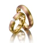 Mat gouden trouwringen-rood en wit goud diamant van 0.06 ct