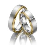 Witgouden trouwringen in damesring drie diamantjes