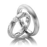 Exclusieve Acredo trouwringen grote diamant in spanzetting - Circles