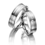Trouwringen in ringen gepolijste banen met twee diamanten