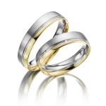 Acredo bi-color trouwringen wit en geelgoud met Saturnusvoeg
