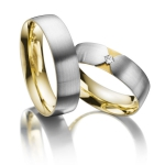 Acredo trouwringen witgoud geelgouden zetting diamant 0.04ct