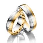 Trouwringen-6,5 mm breed verspringend gezet met 8 diamanten