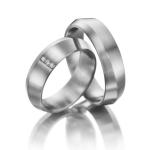 Trouwringen asymmetrisch afgeschuind drie diamantjes 0.03ct