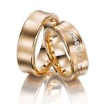 Rosé gouden trouwringen met mooi golfpatroon 7 diamanten