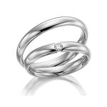 Klassieke witgouden trouwringen van Sickinger met diamant 0.05 ct