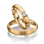 Rosé gouden trouwringen met spanzetting diamant van 0.08ct