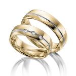 Bi-color ringen van geelgoud met witgouden baan. 14 karaat