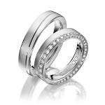 Aparte set 9 karaat trouwringen mooi aan de zijkant gezet met diamant - Circles