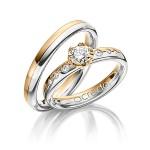 Trouwringen Platina in combinatie met roségoud en grote diamant - Circles