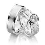 Trouwringen 18 karaat witgoud met prachtig grote diamant en kleine rondom - Circles