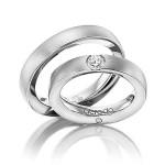 Solide platina trouwringen met diamant van 0.03ct - Circles